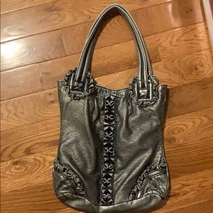 Funky pewter leather bag by Marc Ecko